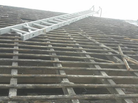 pitched roof replacement Oldham old tiles removed